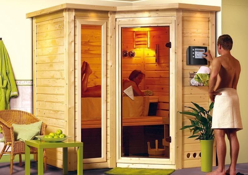 Karibu Massiv Sauna Sahib 1 easy (Eckeinstieg) 40 mm mit Dachkranz inkl. Ofen 9 KW ext. Steuerung